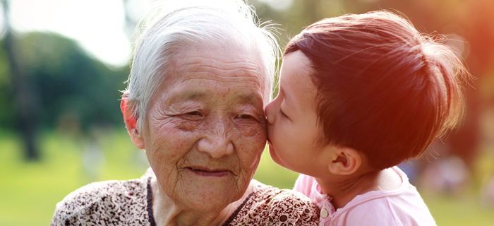 elderly asian woman and child